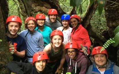 Projects Abroad volunteer prepare for their ziplining experience through the Costa Rican forest